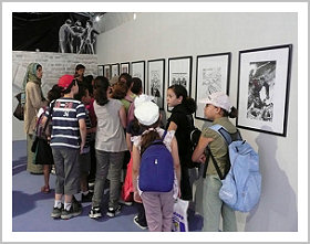 A group of children at an art exhibit.