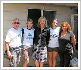 Ambassador Fountain Smith poses with Canadian Habitat for Humanity Volunteers as well as a member of the partner family.