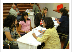 Embassy staff assisting Canadians in need at a temporary office located in a Santiago hotel.