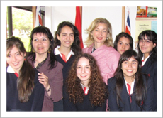 Ambassador Sarah Fountain Smith surrounded by students who participated in the essay competition