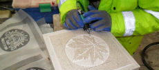 A stonemason from the Commonwealth War Graves Commission works on part of the memorial
