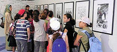 A group of children at an artistic exhibit