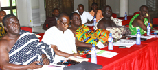 A group of chiefs listen as they learn more about extractive revenues