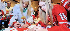 Canadian and Hungarian players are signing a hockey jersey designed to celebrate the 50th anniversary of Canada-Hungary diplomatic relations.