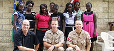 Capt Philippe-Andre Genest; Col Sean Ward; Maj Chris Lindsay with students at the Canada House Business School.