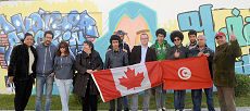 Ambassador Beaulieu with the graffiti team in front of the freshly painted mural