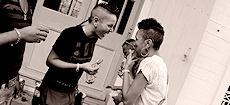 A same sex couple shares laughter during the Collectif Arc En Ciel campaign