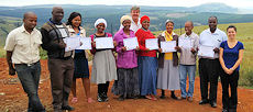 Farm management workshop participants receive a certificate for their achievements