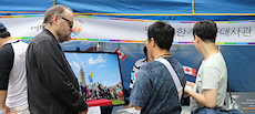 The photo of Trudeau raising the pride flag in Ottawa was on display at the Canada exhibition booth