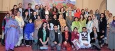 Participants gather for a group photo after the Women's Economic Empowerment forum.