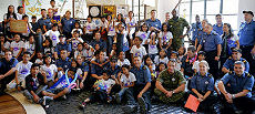 Crew of the HMCS Regina with the children from Ulingan