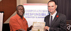 Nana Kobina Nketsia V, a traditional Ghanaian leader, receives a certificate upon completing the McGill Executive Course on Corporate Social Responsibility.