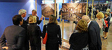 Visitors take a guided tour of the exhibition.