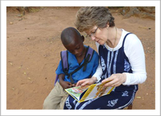 Kathy Knowles and a young reader
