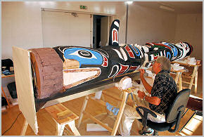 Conservator Andrew Todd completing his work on the totem pole.