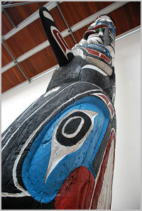 The totem pole restored, and on display.