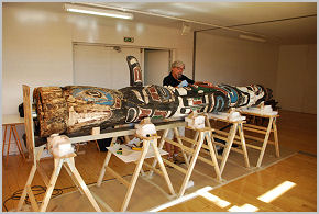 Conservator Andrew Todd gets to work on restoring the totem pole.