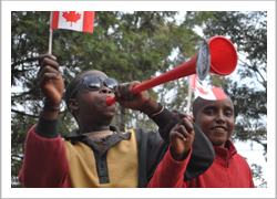 Young enthusiastic soccer fans blow 'vuvuzelas,' trumpet-like devices used for cheering that symbolized the 2010 FIFA World Cup.