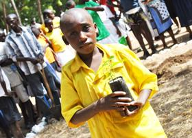 A school child in Malindi holds a seedling before planting