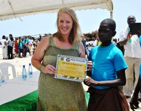Melanie Boyd presents a certificate to a child