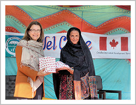 Canadian Head of Aid Rhonda Gossen-Ehsani presents a gift to Mukhktar Mai.