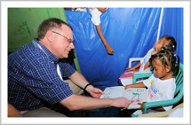 Ambassador views a child's art