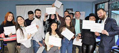 Participants receive certificates after completing peace journalism training